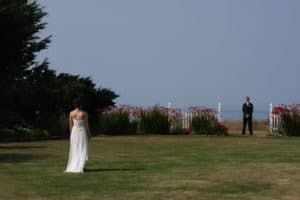 bride and groom eloping in a field at Sea Cliff Gardens B&B in Washington State