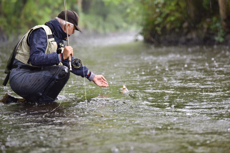 older man flyfishing WIIN