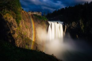 a rainbow over snoqualme falls in Washington State